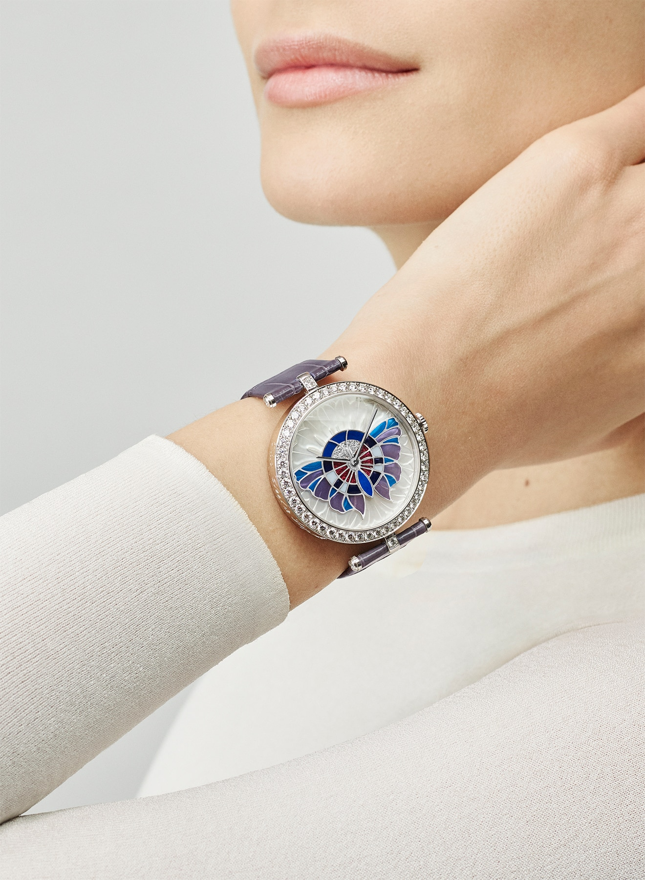 Extraordinary Dials collection, watch, white gold, diamonds and mother-of-pearl, hand resting on neck, Van Cleef & Arpels