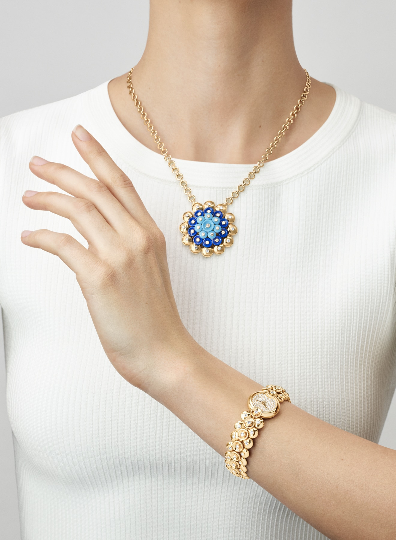 High Jewelry watches collection, watch and necklace, yellow gold and diamonds, hand pointing upwards, Van Cleef & Arpels