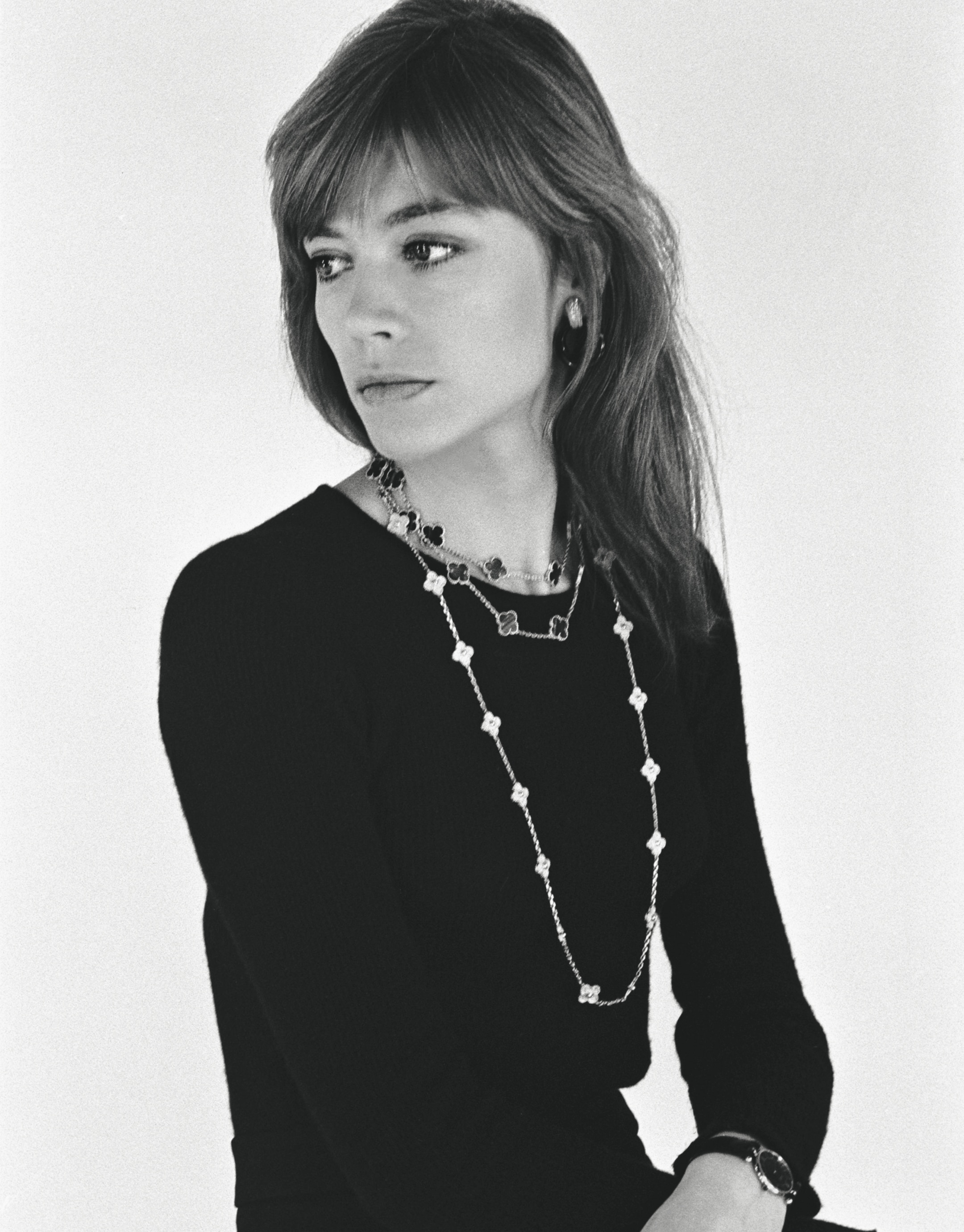 Françoise Hardy is wearing two Alhambra sautoirs and a PA 49 wristwatch, 1973, Van Cleef & Arpels Archives