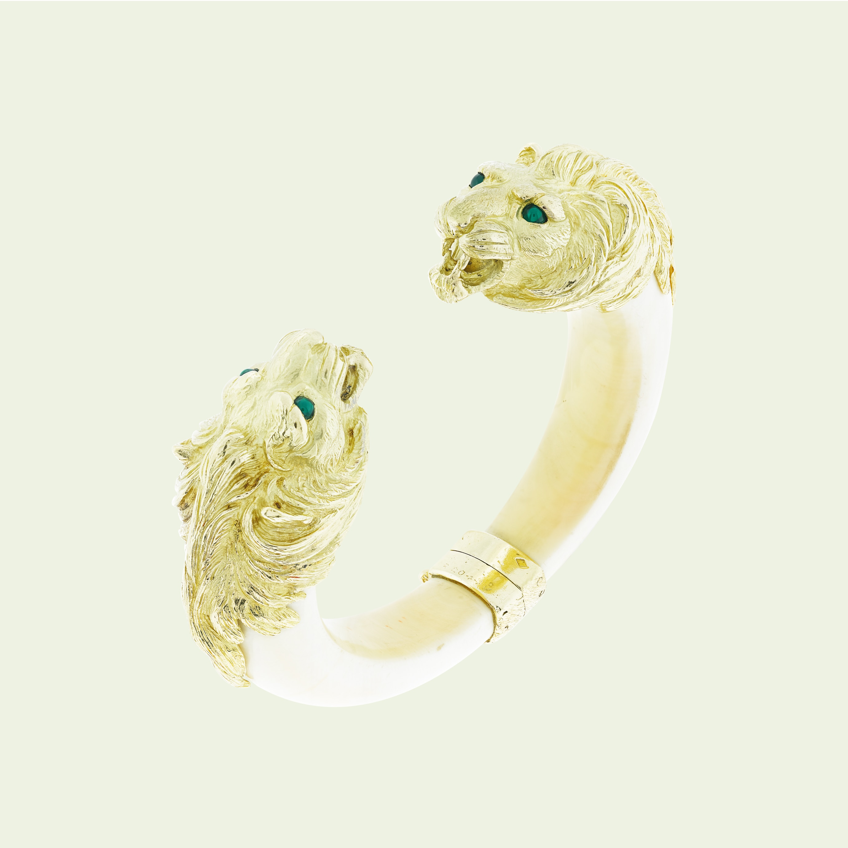 Two lion heads bracelet, 1974, yellow gold, chrysoprases, ivory. Van Cleef & Arpels.
