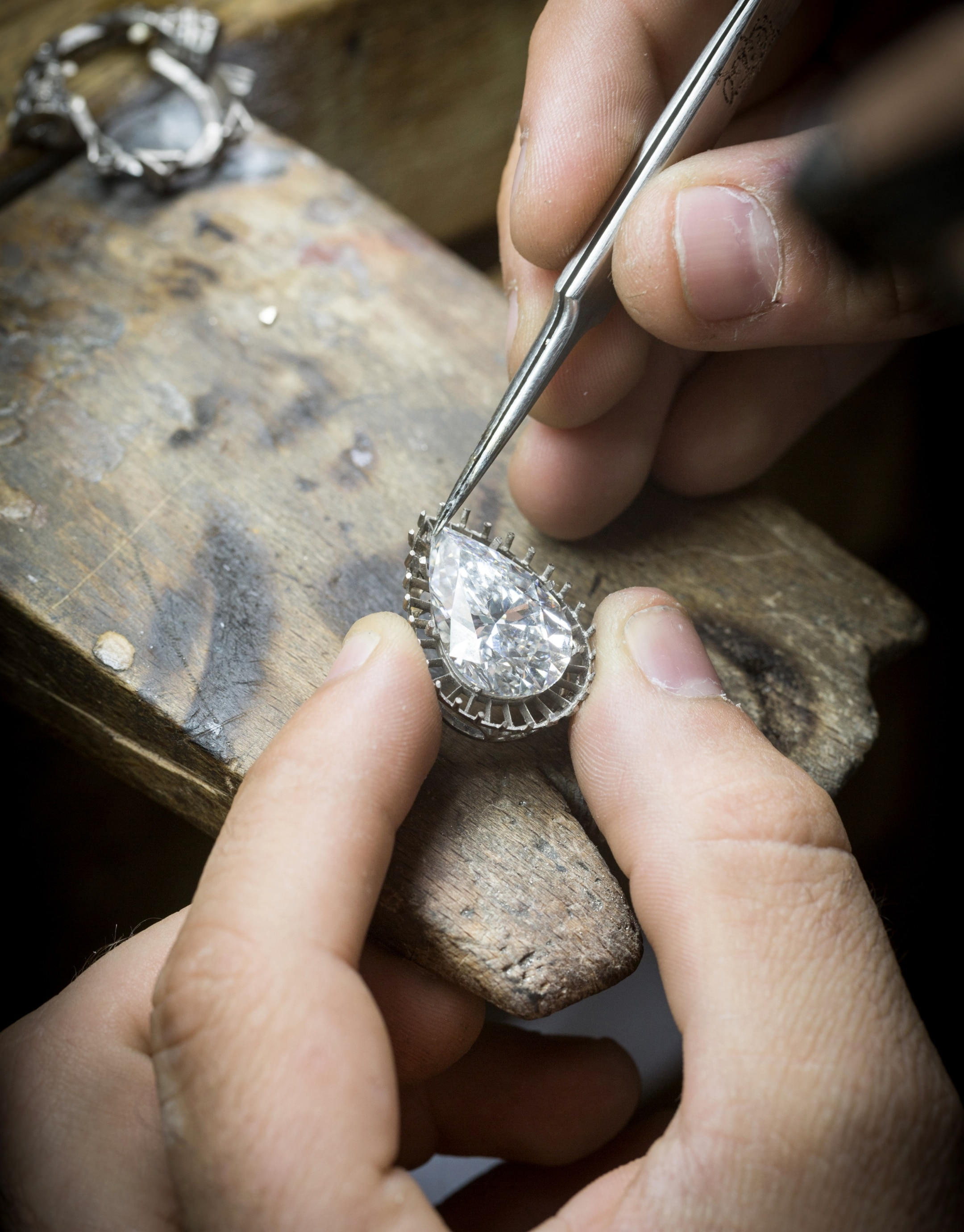 Checking the adjustment of the center diamond on the motif, Bleu Absolu necklace.